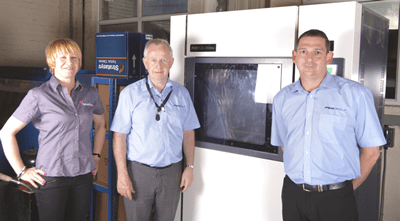 The Peak Group beside their Stratasys Fortus 360 which is replacing traditional tooling